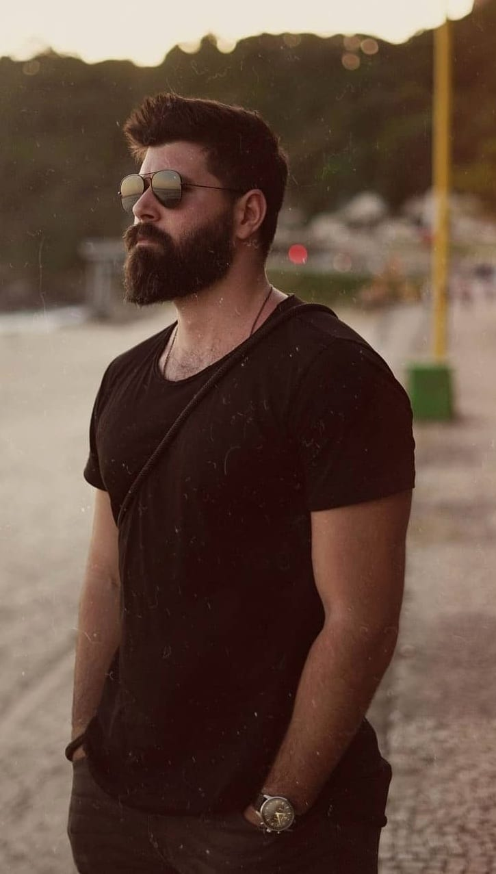 Black shirt,pant and glasses with Ducktail beard look