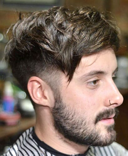 Long top Short Sides hairstyle with beard for men