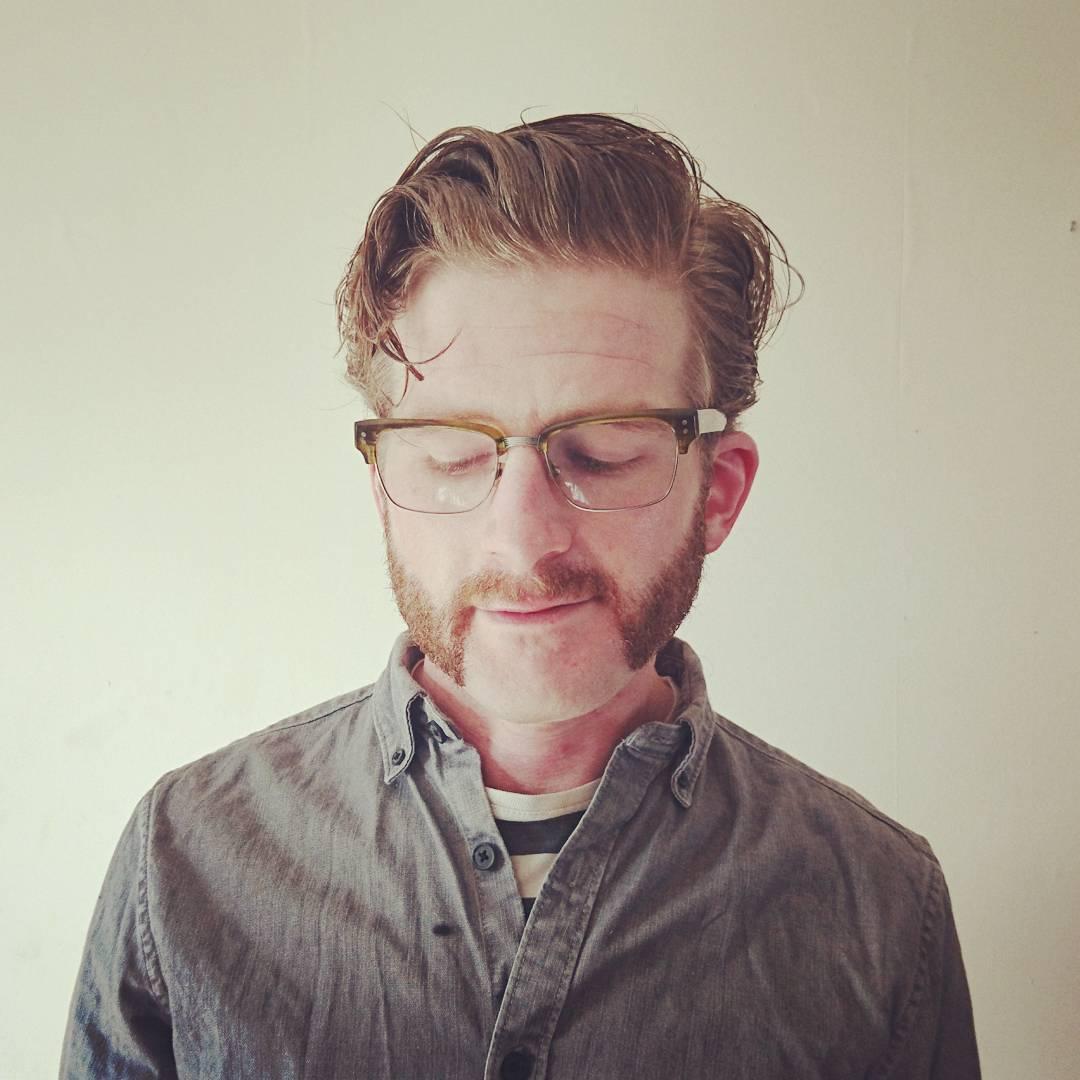 mutton-chop-beard-with-medium-hair